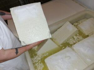 How cheese is made - a block of goat feta cheese