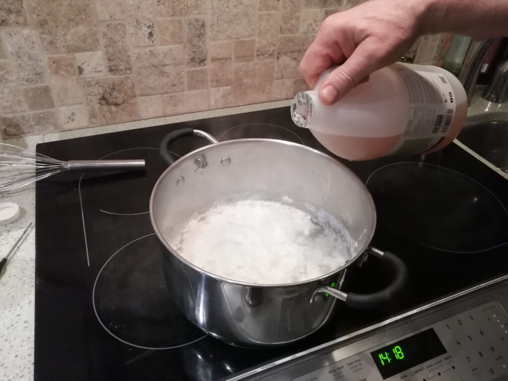 How to make cheese at home - acidifying the milk with vinegar